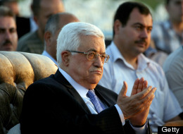 President of the Palestinian National Authority Mahmoud Abbas claps during the opening ceremony of a new hospital in the West Bank city of Jenin, as he visits the area, on July 28, 2012. (SAIF DAHLAH/AFP/GettyImages)