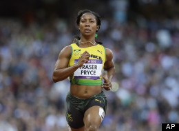 FILE: Jamaica's Shelly-Ann Fraser-Pryce, left, and Trinidad's Semoy Hackett go to cross the finish line in a women's 100-meter heat during the athletics in the Olympic Stadium at the 2012 Summer Olympics, London, Friday, Aug. 3, 2012. (AP Photo/Anja Niedringhaus)