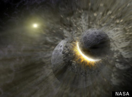 Artist's rendering shows planetary collision near the star Vega. The Moon may have formed from the debris of such an impact between Earth and a Mars-sized body, NASA says.