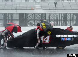 LONG POND, PA - AUGUST 05: Crew members push the #14 Office Depot Back to School Chevrolet, driven by Tony Stewart, back to the garage as rain falls during the NASCAR Sprint Cup Series Pennsylvania 400 at Pocono Raceway on August 5, 2012 in Long Pond, Pennsylvania.