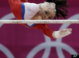 Russian gymnast Aliya Mustafina performs on the uneven bars during the Artistic Gymnastic women's qualifications at the 2012 Summer Olympics, Sunday, July 29, 2012, in London. (AP Photo/Julie Jacobson)