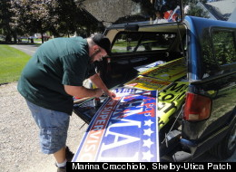 Matt Guarnieri was seen painting on political signs with red paint from the back of his vehicle just moments before an altercation between him and Shelby Township Clerk candidate Lisa Manzella, her husband and the wife of candidate for supervisor broke out. (Marina Cracchiolo / Patch)