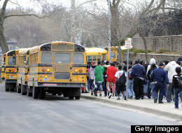 KANSAS CITY, MO - MARCH 11: Students walk in line and prepare to leave on school buses from Westport High School on March 11, 2010 in Kansas City, Missouri.