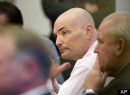 Eric Naposki looks toward jurors as they are polled following a guilty verdict at Orange County Superior Court in Santa Ana, Calif. Thursday July 14, 2011. A jury on Thursday found the former New England Patriots and Indianapolis Colts linebacker guilty of killing Southern California millionaire William McLaughlin nearly 17 years ago. Sentencing is scheduled for Oct. 21. (AP Photo/H. Lorren Au Jr., Pool)