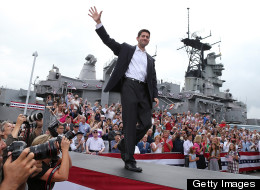 Rep. Paul Ryan, (R-Wis.), waves to a crowd in Norfolk, Va., as he is announced by presumptive Republican presidential candidate Mitt Romney as his running mate. (Photo by Justin Sullivan/Getty Images)