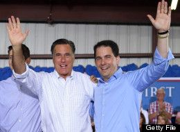 JANESVILLE, WI - JUNE 18: Republican presidential candidate, former Massachusetts Gov. Mitt Romney and Wisconsin Governor Scott Walker, (L-R) wave together during a campaign event at Monterey Mills on June 18, 2012 in Janesville, Wisconsin.(Photo by Joe Raedle/Getty Images)