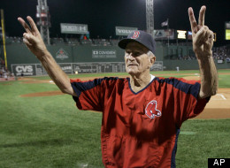 Boston Red Sox legend Johnny Pesky gestures to cheering fans as his 88th birthday is celebrated with a cake prior to their baseball game against the Minnesota Twins at Fenway Park in Boston Thursday, Sept. 27, 2007.