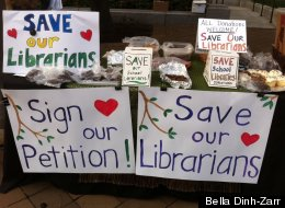 Parents display baked goods for sale at a July event outside D.C. city hall publicizing a petition to keep librarians in all D.C. public schools.