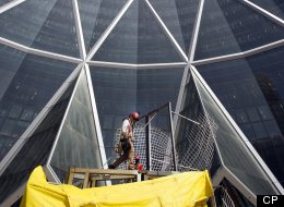 Workers put final touches to the main entrance outside the Bow Building in downtown Calgary, Alberta. (CP)