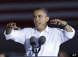 President Barack Obama speaks during a campaign stop Aug. 14 in Waterloo, Iowa. The president is on a three-day campaign bus tour through the state. (AP Photo/Charlie Neibergall)