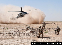 A Blackhawk helicopter lifts wounded troops from a battlefield in Afghanistan.