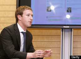 Facebook CEO Mark Zuckerberg speaks to Japan's Prime Minister Yoshihiko Noda (unseen) in front of a monitor displaying a facebook page of Prime Minister's Office of Japan in Tokyo on March 29, 2012. (YURIKO NAKAO/AFP/Getty Images)