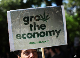 A man holds a poster while taking part in a march celebrating cannabis culture. (AP Photo/Armando Franca)