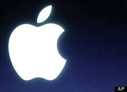 Apple logo during announcement at Apple headquarters in Cupertino, Calif., Tuesday, Oct. 4, 2011. (AP Photo/Paul Sakuma)