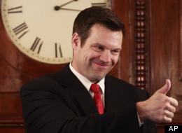 Kansas Secretary of State Kris Kobach gives a thumbs up to House members during their opening session in Topeka, Kan., on Jan. 10, 2011. (AP Photo/Orlin Wagner)