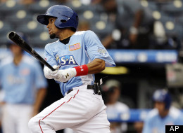 United States' Billy Hamilton hits a two-run triple during the third inning of the MLB All-Star Futures baseball game against the World in Kansas City, Mo.