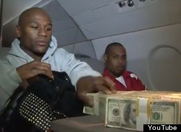 Floyd Mayweather counts his money on a private jet.