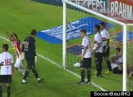 Nautico players celebrate goalkeeper Rogerio Ceni's own goal as Sao Paulo FC players look on in disbelief, 3-0.