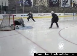 Pittsburgh Penguins' Sidney Crosby and Scott Parse of the L.A. Kings practice hockey drills with teenage goaltender Tomas Scholl.