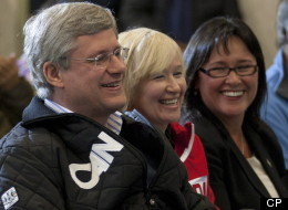 Canadian Prime Minister Stephen Harper, Laureen Harper and Minister of Health Leona Aglukkaq(right) laugh during an announcement in Cambridge Bay, Nunavut, Thursday, August 23, 2012. Aglukkaq was named as the next Chair of the Arctic Council. (THE CANADIAN PRESS/Adrian Wyld)