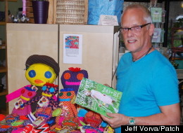 Steve English poses in his shop with the summer edition of Chicago Special Parent magazine, which features a cover story on his Changing the Face of Beauty program.
