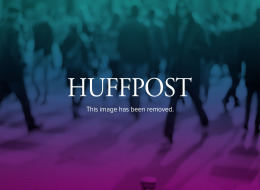 Lance Armstrong, left, and Johan Bruyneel, sporting director of the Discovery team, pose on the Champs Elysees during a victory parade after Armstrong won his seventh straight Tour de France cycling race in Paris on July 24, 2005.