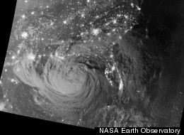 Early on August 28, 2012, the Visible Infrared Imaging Radiometer Suite (VIIRS) on the Suomi-NPP satellite captured this nighttime view of Tropical Storm Isaac and the cities near the Gulf Coast of the United States.