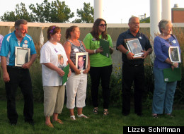Overdose prevention advocates holding photos of loved ones lost to heroin and other opiates accept Courage Awards recognizing their efforts at a vigil at Roosevelt University in Schaumburg. (Lizzie Schiffman)