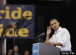 TOLEDO, OH - SEPTEMBER 3: U.S. President Barack Obama puts his hand to his ear durig a speech at Scott High School on September 3, 2012 in Toledo, Ohio. (Photo by J.D. Pooley/Getty Images)