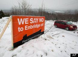 An anti-Enbridge placard stands on a property owner's lawn. (AP)