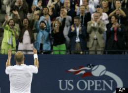 Andre Agassi acknowledges the crowd as they cheer after he defeated Marcos Baghdatis at the US Open in New York, Thursday, Aug. 31, 2006.