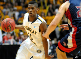 Murray State's Zay Jackson drives around St. Mary's Rob Jones during the second half of an NCAA college basketball game on Saturday, Feb. 18, 2012, in Murray, Ky. Murray State won 65-51.