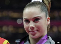 U.S. gymnast McKayla Maroney displays her silver medal during the podium ceremony for the artistic gymnastics women's vault finals at the 2012 Summer Olympics, Sunday, Aug. 5, 2012, in London.