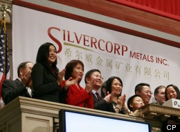 Employees and guests of Silvercorp Metals attend the opening bell at the New York Stock Exchange, Monday, March 8, 2010. A Canadian who helped write a scathing report alleging accounting irregularities at Silvercorp has spent the last eight months languishing in Chinese jails. (AP Photo/Mark Lennihan)