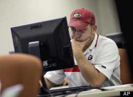 In this Aug. 22, 2012 photo, David Staten, right, of Chatsworth, Ga., files for unemployment after being laid off from a construction job in Dalton, Ga. Younger workers are having more success re-entering the labor market after layoffs during the Great Recession.  (AP/David Goldman)