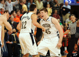 Notre Dame forward Jack Cooley racts after a basket in an NCAA college basketball game Jan. 21, 2012 in South Bend, Ind. . (AP Photo/Joe Raymond)