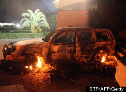 A vehicle sits smoldering in flames after being set on fire inside the US consulate compound in Benghazi late on September 11, 2012. (STR/AFP/GettyImages)