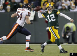 Green Bay Packers quarterback Aaron Rodgers (12) throws while being pressured by Chicago Bears middle linebacker Brian Urlacher (54) during the first half of an NFL football game Sunday, Dec. 25, 2011, in Green Bay, Wis. (AP Photo/Jeffrey Phelps)