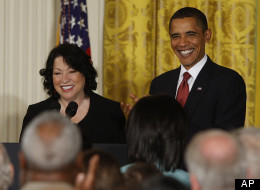 President Barack Obama and new Supreme Court Justice Sonia Sotomayor are seen in the East Room of the White House in Washington, Wednesday, Aug. 12, 2009, during a reception in her honor. (AP Photo/Ron Edmonds)