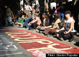 Protestors in San Francisco sit during the Occupy movement's one year anniversary rally.