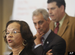 Vincent Iturralde, right, principal at Tarkington School of Excellence, and Chicago Mayor Rahm Emanuel listen as Mahalia Hines, a member of the Chicago Board of education and former Chicago Public Schools teacher and principal, speaks during a news event in Chicago