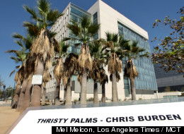 A laminated faux-plaque is located next to a row of palm trees by LAPD Headquarters in downtown Los Angeles, California on September 13, 2012. The sign, purported to be from the city of Los Angeles, said the