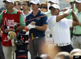 Tiger Woods hits from the tee on the 13th hole during the first round of the Tour Championship golf tournament, Thursday, Sept. 20, 2012, in Atlanta.