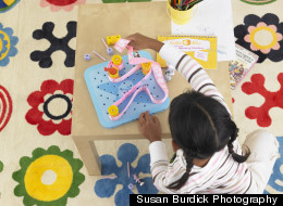 One of Sterling's product testers engages with GoldieBlox.