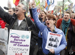 The Conservative government won't be turning over any more documents to help Canada's budget watchdog Kevin Page discover what federal jobs will be slashed or what government services will be eliminated. Hundreds of people march in downtown Ottawa in protest of federal budget cuts on Tuesday, May 1, 2012. (CP)