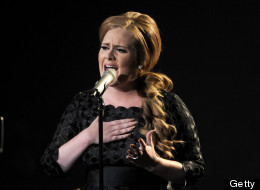 Eight-time Grammy winner Adele slams stars who resort to stripping to sell records.