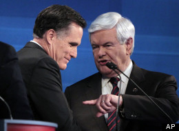 Former Massachusetts Gov. Mitt Romney and former House Speaker Newt Gingrich (R-Ga.) talk at the end of the South Carolina Republican presidential candidate debate on Jan. 16. (AP Photo/Charles Dharapak, Pool)