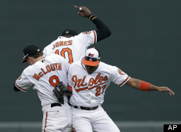 Baltimore Orioles' Nate McLouth, left, Adam Jones and Endy Chavez celebrate after a baseball game against the Boston Red Sox in Baltimore, Sunday, Sept. 30, 2012. Baltimore won 6-3.