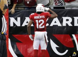 Arizona Cardinals wide receiver Andre Roberts (12) celebrates his touchdown against the Miami Dolphins during the second half of an NFL football game, Sunday, Sept. 30, 2012, in Glendale, Ariz. The Cardinals won 24-21 in overtime.