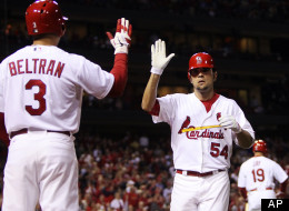 St. Louis Cardinals' Jaime Garcia is congratulated by Carlos Beltran as he returns to the dugout after hitting a solo home run against the Cincinnati Reds in the third inning of a baseball game, Monday, Oct. 1, 2012, in St. Louis.